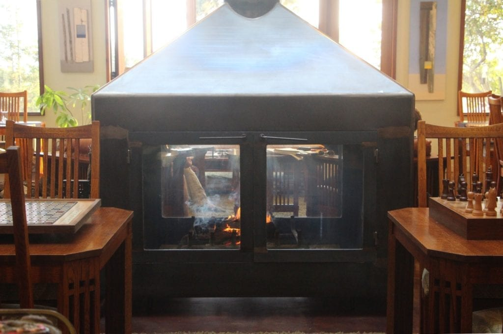 The glass and steel fireplace in the great room was custom-fabricated by a local shipbuilder.