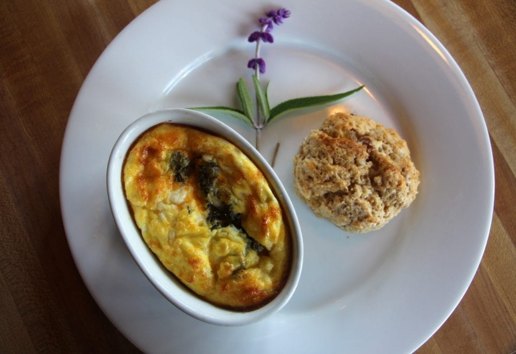 Baked pesto eggs served with a warm apple ginger scone