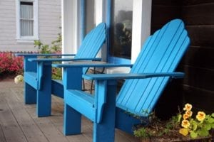 Adirondack chairs on the front porch of the inn